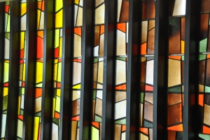 Stained glass running along the back of the narthex.  Jehovah Lutheran Church, photograph by author.