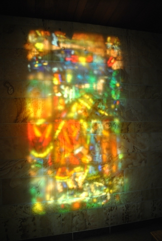 Reflection of stained glass across a side altar, Blue Cloud  Abbey, Marvin SD, July 2015, photograph by author.
